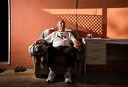 Cedomir Bogunovic, 75, waits on the porch of his midtown home for the sun to rise every morning, Tucson, Arizona, USA.