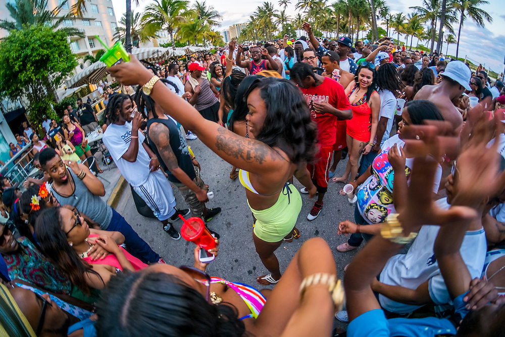 MIAMI BEACH - MAY 25: Girl dancing in the street during the Urban Beach Weekend, on May 25, 2013 in Miami Beach. This is the largest Urban Festival in the World, that caters towards the Hip Hop Generation. Over 300.000 participants make the annual trek to South Beach for 4 days full of fun, food, festivities, entertainment, music, and more.