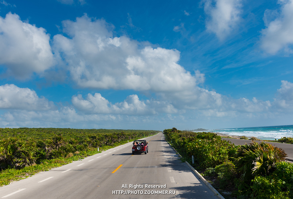 Open Top Red Jeep On Empty Seaside Road, Cozumel, Mexico