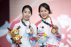 JAKARTA, Aug. 19, 2018  China's Qian Jiarui (R) and her teammate Shao Yaqi pose for pictures during the awarding ceremony of Women's Sabre Individual Gold Medal Bout of the 18th Asian Games in Jakarta, Indonesia, Aug. 19, 2018. (Credit Image: © Zhu Wei/Xinhua via ZUMA Wire)