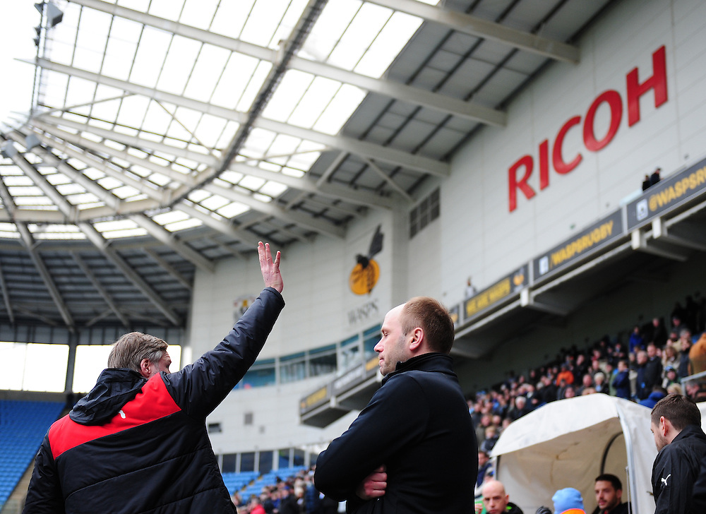 Fleetwood Town manager Steven Pressley waves to someone in the stands as he prepares for his side to take on his previous club Coventry City<br /> <br /> Photographer Chris Vaughan/CameraSport<br /> <br /> Football - The Football League Sky Bet League One - Coventry City v Fleetwood Town - Saturday 27th February 2016 - Ricoh Stadium - Coventry   <br /> <br /> © CameraSport - 43 Linden Ave. Countesthorpe. Leicester. England. LE8 5PG - Tel: +44 (0) 116 277 4147 - admin@camerasport.com - www.camerasport.com