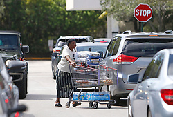 People walking out with water and necessities at Costco Wholesale in preparation for the arrival of Hurricane Irma on Wednesday, September 6, 2017 in North Miami, FL, USA. Photo by David Santiago/Miami Herald/TNS/ABACAPRESS.COM