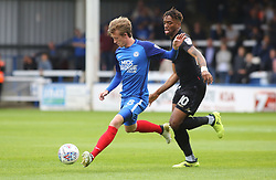 Chris Forrester of Peterborough United plays the ball away from Ivan Toney of Wigan Athletic - Mandatory by-line: Joe Dent/JMP - 23/09/2017 - FOOTBALL - ABAX Stadium - Peterborough, England - Peterborough United v Wigan Athletic - Sky Bet League One
