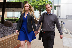 © Licensed to London News Pictures. 27/05/2015. London, UK. Former UBS and Citigroup trader Tom Hayes with his wife, Sarah leaves Southwark Crown Court in London. Hayes appears charged with eight counts of conspiracy to defraud in relation to alleged manipulation and rigging of the Libor rate. Photo credit : Vickie Flores/LNP