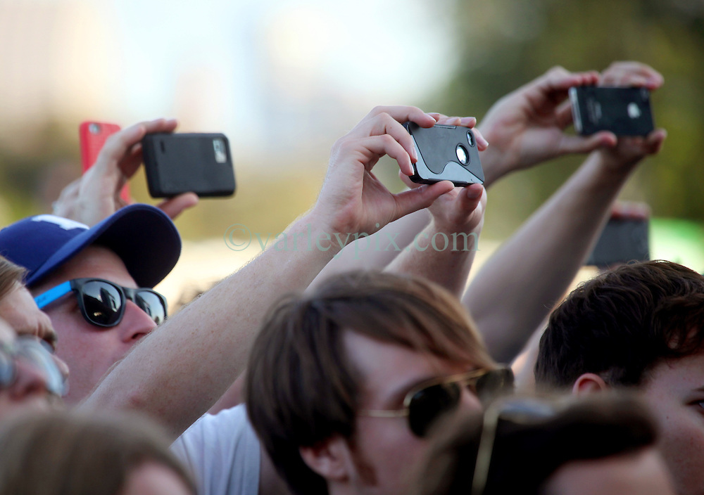 27 April 2012. New Orleans, Louisiana,  USA. .New Orleans Jazz and Heritage Festival. .Cell phones capture all the action for immediate downloads of  Emmy award winning band Bon Iver..Photo; Charlie Varley.