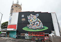 "© Licensed to London News Pictures. 24/07/2016. Bristol, UK.  ""The Last Unicorn"" by Louis Masai, on the side of the Red Point Climbing Centre at Upfest street art festival 2016, Europe's largest, free, street art & graffiti festival, attracting over 300 artists painting 28 venues throughout Bedminster & Southville, Bristol.  Photo credit : Simon Chapman/LNP"
