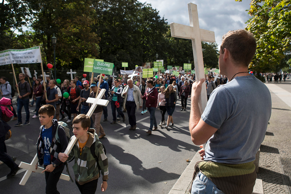 """Participants in """"The March For Life"""" are seen carrying crosses as they march through Berlin's Mitte district, on September 16, 2017. In the center of the pro-life event was the call by the organizers for German politicians and society to take active action against a """"silent increase of acceptance"""" of the phenomenon. Abortion in Germany is permitted in the first trimester of the pregnancy, with the condition of mandatory counseling and in a later period of the pregnancy in cases of medical necessity.<br /> (Photo by Omer Messinger)"""
