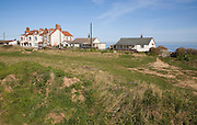 Cliff top houses all but one now empty at risk from coastal erosion, Happisburgh, Norfolk, England