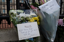 © Licensed to London News Pictures. 09/04/2021. LONDON, UK. Flowers and tributes left by well wishers outside Buckingham Palace after the death of Prince Philip, aged 99, was announced.  Photo credit: Stephen Chung/LNP