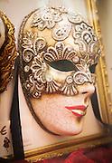 Venetian Masquerade mask in a shop window in Venice, Italy, Europe
