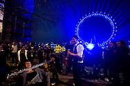 People are celebratingthe New Year in Westminster, near London Eye, in London. BOGDAN MARAN 1989 / BIG PICTURES
