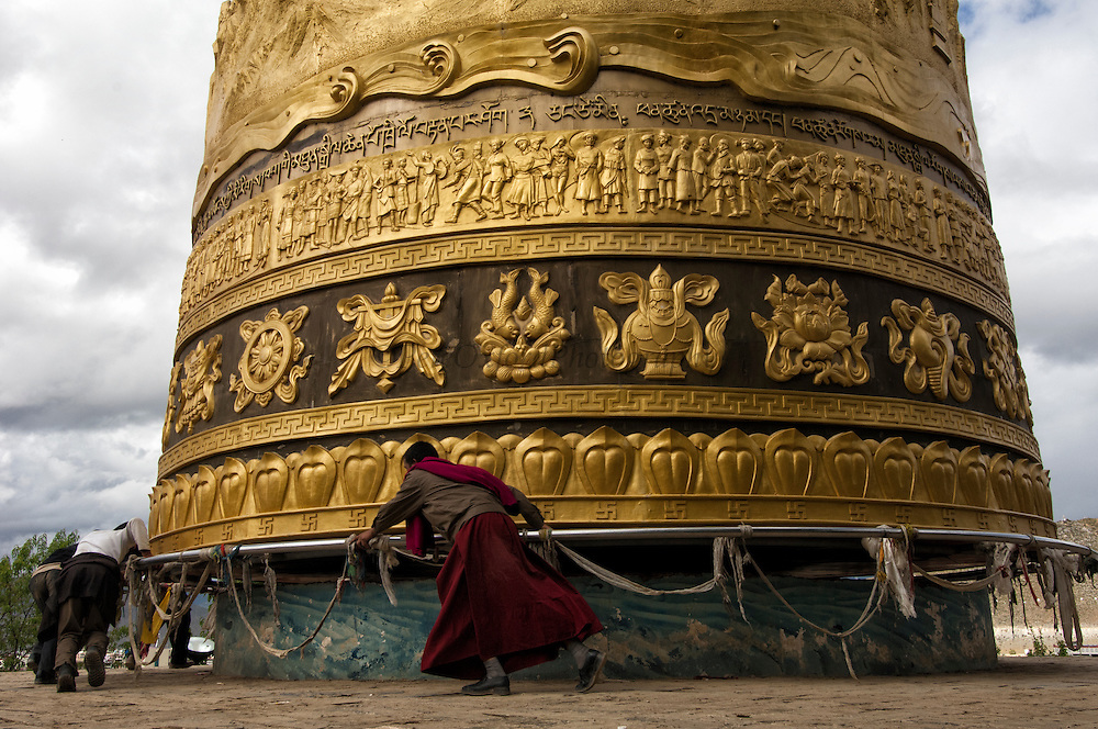 Largest Prayer Wheel in the world.  Zhongdian. Deqin Tibetan Autonymous Prefecture. Yunnan Province. CHINA<br /> There are over 100,000 Tibetans in China and they are mostly concentrated in Deqin with smaller communities in Lijiang, Yongsheng, Gongshan and Ninglang.