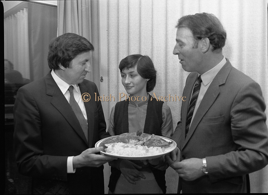 """""""The National Fish Cookery Award""""..29.04.1982..04.29.1982.29th April 1982..This competition sponsored by Bord Iascaigh Mhara was held in The Clare Inn, Newmarket-on Fergus,Co Clare. the competition was open to schools across the country..Catherine O' Sullivan listens as Minister Daly and Mr Vivian Murray, Chairman, Bord Iascaigh Mhara, discuss her winning entry."""
