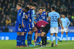 19th December 2017 - Carabao Cup (Quarter Final) - Leicester City v Manchester City - Players stand their grounds as referee Robert Madley deploys the vanishing spray - Photo: Simon Stacpoole / Offside.