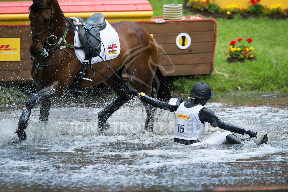 Dee Hankey (GBR) & Chequer's Playboy fall at the DHL Water Complex - Cross Country - Luhmuhlen CCI4* - Salzhausen, Germany - 14 June 2013