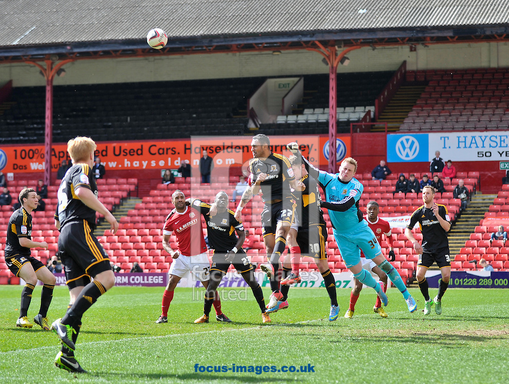 Picture by Richard Land/Focus Images Ltd +44 7713 507003.27/04/2013.David Stockdale of Hull City punches clear during the npower Championship match at Oakwell, Barnsley.