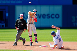 May 13, 2018 - Toronto, ON, U.S. - TORONTO, ON - MAY 13: Boston Red Sox Infield Brock Holt (12) turns a double play over top of Toronto Blue Jays Designated hitter Kendrys Morales (8) during the MLB game between the Boston Red Sox and the Toronto Blue Jays on May 13, 2018 at Rogers Centre in Toronto, ON. (Photo by Jeff Chevrier/Icon Sportswire) (Credit Image: © Jeff Chevrier/Icon SMI via ZUMA Press)