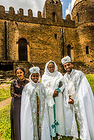A bride and groom having their wedding photos taken at Emperor Fasilides Castle, known as the Royal Enclosure (or Fasil Ghebbi) is the remains of a fortress-city in Gondar, Ethiopia.