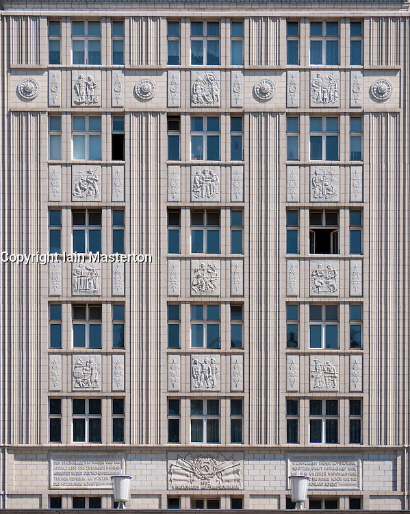 Facades of old socialist GDR era apartment buildings on Karl Marx Allee in former East Berlin Germany