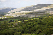 Views towards the rocky scarp slope of the carboniferous limestone upland area of the Burren, near Ballyvaughan, County Clare, Ireland