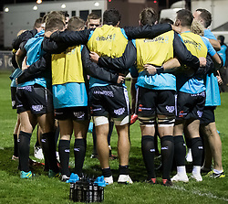 Ospreys forwards huddle during the pre match warm up<br /> <br /> Photographer Simon King/Replay Images<br /> <br /> Guinness PRO14 Round 7 - Ospreys v Connacht - Friday 26th October 2018 - The Brewery Field - Bridgend<br /> <br /> World Copyright © Replay Images . All rights reserved. info@replayimages.co.uk - http://replayimages.co.uk