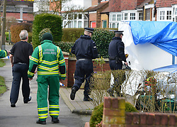 © Licensed to London News Pictures. 13/04/2013. Ruislip, UK Police and ambulance crews at the scene where a woman and two children have been found dead at a house in Ruislip, West London. Police were called by London Ambulance Service at approx 1840 hrs on Friday 12 April to reports of a woman and two children found deceased at an address in Midcroft Road. Photo credit : Stephen Simpson/LNP