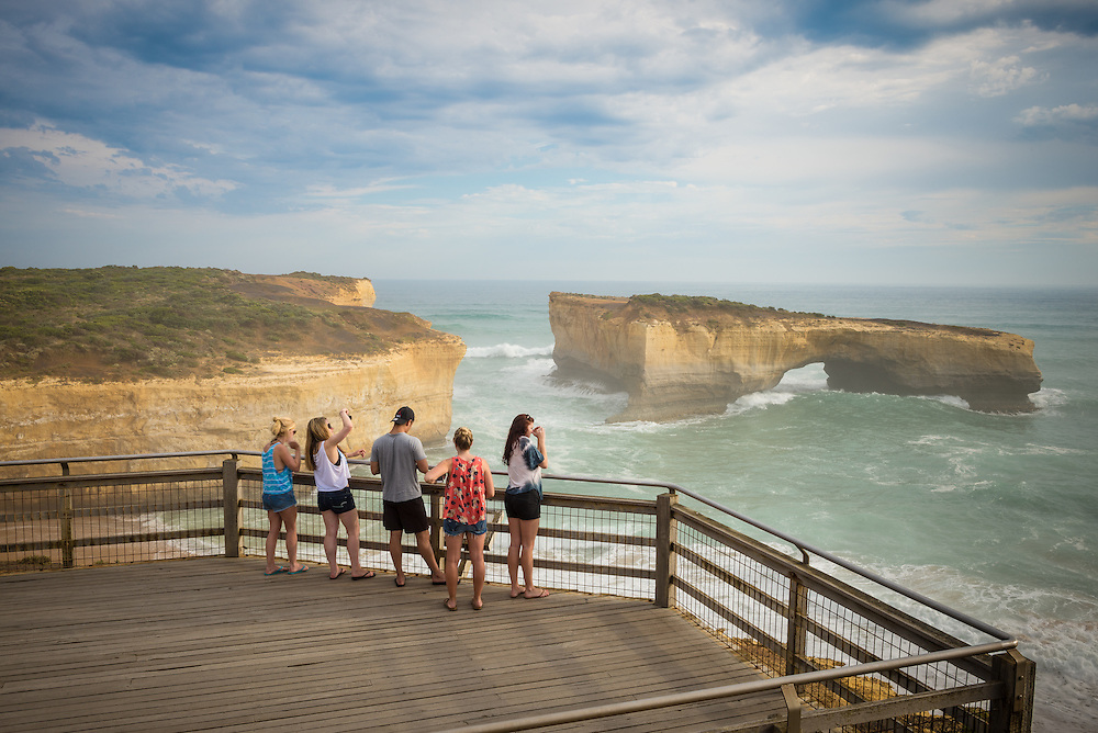 Visitors view London Bridge on the Great Ocean Road from a viewing platform