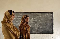 Mukhtar Mai, 33, left, and her best friend Naseem Akhter, visit the boys school she started, Meerwala, Pakistan, April 29, 2005.<br />
