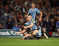 Photo: Rich Eaton.<br /> <br /> Cardiff Blues v Leicester Tigers. Heineken Cup. 29/10/2006. Ollie Smith of Tigers is tackle by Blues Tom Shanklin and Smith hurts his left knee badly, leaving the pitch shortly afterwards