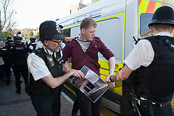 © Licensed to London News Pictures.20/04/2016. Bristol, UK.  A man is arrested by police at a protest outside an auction of council houses held at All Saints Church in Pembroke Road, Clifton, Bristol. Campaigners want the council to stop selling off 14 council homes on 20 April by auction to the private sector. Bristol City Council says the homes are expensive to repair, but some campaigners question whether the costs of repairs are inflated, and also whether the homes will be bought and then relet to the Council for temporary accommodation at higher than normal rents.  A group of residents of St. Paul's and the Inner City are campaigning against the sale. They are working in partnership with The Community Rights Project, The Bristol People's Assembly, and members of the ACORN community union. Photo credit : Simon Chapman/LNP