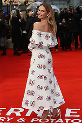 April 9, 2018 - London, England, U.K. - Actress LILY JAMES arriving at the premiere for her latest film, 'The Guernsey Literary and Potato Peel Pie Society' in London. (Credit Image: © Stephen Lock/i-Images via ZUMA Press)