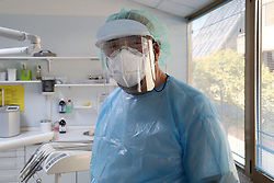 Dr. Paolo D'Angelo, partner of the Comedent dental practice dressed in the protections prescribed by the Ausl to combat Coronavirus while visiting a patient in Modena, Italy on May 7, 2020. Photo by Roberto Brancolini/IPA/ABACAPRESS.COM