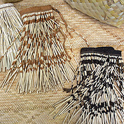Weaved products made at Te Puia's Weaving School, Rotorua,  New Zealand. Te Puia is the premier Maori cultural centre in New Zealand - a place of gushing waters, steaming vents, boiling mud pools and spectacular geysers. Te Puia also hosts National Carving and Weaving Schools and  daily maori culture performances including dancing and singing. Rotorua, 9th December 2010 New Zealand.  Photo Tim Clayton.