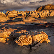 Among the lingering shadows awaiting the night at Bisti Badlands in northwest New Mexico