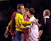 Photo: Jed Wee.<br />Liverpool v Charlton Athletic. The Barclays Premiership. 04/03/2006.<br />Charlton's Thomas Myhre (L) with fellow Norwegian John Arne Riise (C) at the end of the match.