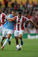 Manchester City's Jack Rodwell battles with Stoke's Jonathan Walters (r)during the Barclays Premier league match, Stoke city v Manchester city at the Britannia Stadium in Stoke on Trent on Sat 14th Sept 2013. pic by Jeff Thomas, Andrew Orchard sports photography,