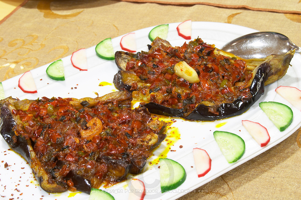 Grilled baked aubergine eggplant with tomatoes and garlic Efendi Efendy traditional Turkish and Ottoman Restaurant, The Block, Tirana. Albania, Balkan, Europe.