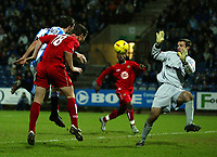 Fotball<br /> England 2004/2005<br /> Foto: SBI/Digitalsport<br /> NORWAY ONLY<br /> <br /> Coca-Cola League 1<br /> 03/01/2005.<br /> <br /> Huddersfield v Bristol City<br /> <br /> Bristol's Tony Dinning heads back across the Huddersfield goal for Leroy Lita to score the first goal