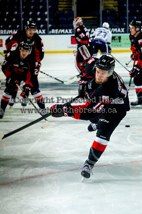 KELOWNA, BC - MARCH 29:  Ethan Browne #19 of the Prince George Cougars warms up with a shot on net against the Victoria Royals at Prospera Place on March 29, 2021 in Kelowna, Canada. (Photo by Marissa Baecker/Shoot the Breeze)