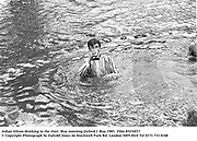 Julian Alison drinking in the river. May morning Oxford.1 May 1983. Party partly organised by Ding Boston, Film 83234f17<br />© Copyright Photograph by Dafydd Jones<br />66 Stockwell Park Rd. London SW9 0DA<br />Tel 0171 733 0108
