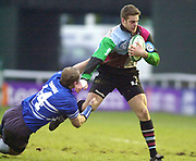 Twickenham, Surrey. UK., 12.01.2002, Quin's Rob Jewell, breaks, Daniel Jones, tackle on his run to the try line, for the first try during the, Harlequins vs Bridgend, Heineken Cup Rugby match at the Stoop Memorial Ground, [Mandatory Credit: Peter Spurrier/Intersport Images],