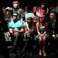 Fashion enthusiasts sit front row by the catwalk during the KTZ spring 2011 collection in the BFC show space at Somerset House, London on 22 September 2010.