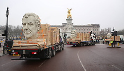 EDITORIAL USE ONLY<br /> Three 8 foot models of the heads of The Grand Tour presenters, Jeremy Clarkson, James May and Richard Hammond pass by Buckingham Palace in London on the back of flatbed trucks after travelling 30,000 miles across 3 continents.