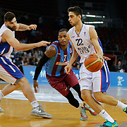 Anadolu Efes's Furkan Korkmaz (R) and Trabzonspor's Dwight Hardy (C) during their Turkish Basketball League Play Off Semi Final round 1 match Anadolu Efes between Trabzonspor at Abdi Ipekci Arena in Istanbul Turkey on Friday 29 May 2015. Photo by Aykut AKICI/TURKPIX
