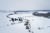 Aerial view of nordic snowy landscape in Estonia.