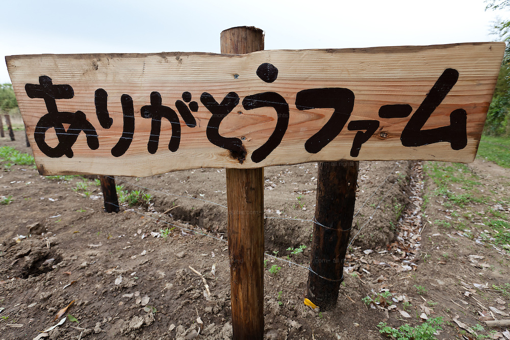 A sign for the Arigato Farm project, Ogawa Machi, Iwaki, Fukushima, Japan. Sunday May 6th 2012
