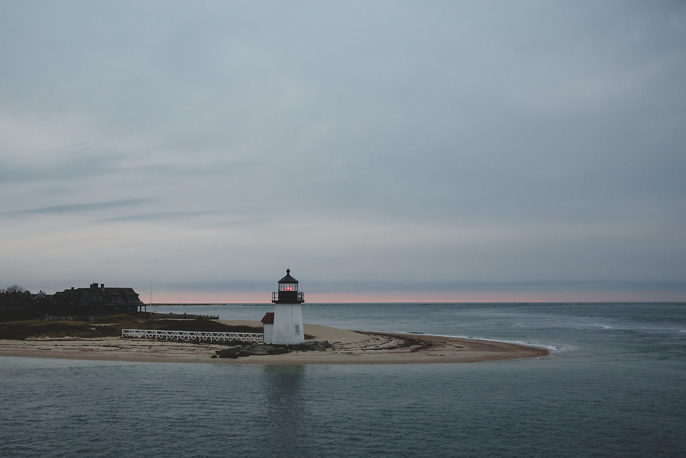 Brant Point light seen on an overcast autumn evening at the entrance to Nantucket Harbor.