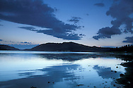 Morning clouds reflected in the quiet still blue water of Big Bear Lake, San Bernardino County, California