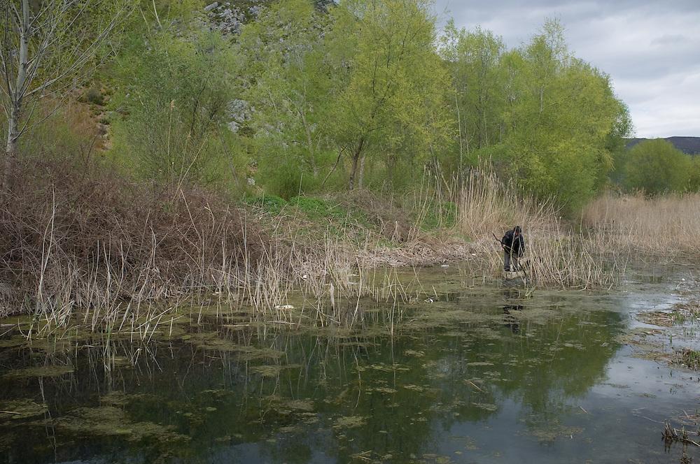 Man fishing in the small Prespa near the village of Tren, Albania