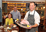 Head chef Eddie gannon with Kate and Andrew Cooke at QC's Restaurant in Cahersiveen, County Kerry. .Picture by Don MacMonagle